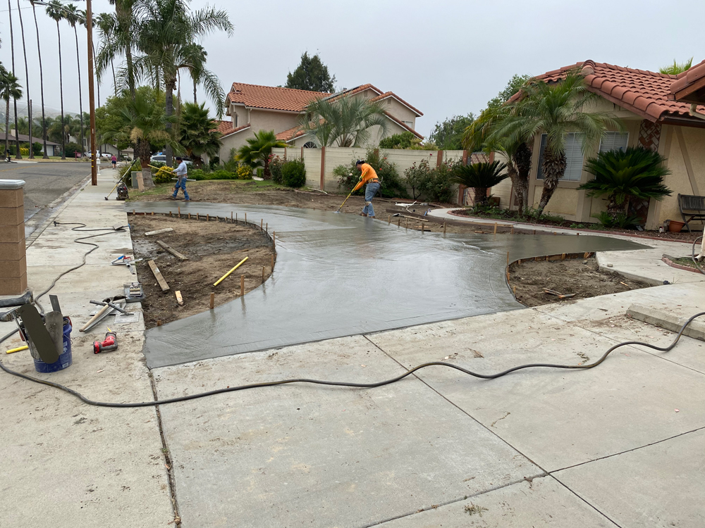 Concrete poured on newly designed Driveway Entry